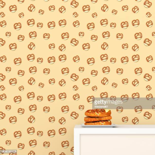 Plate with pretzels on cup board in front of wallpaper with pretzel pattern, 3D Rendering