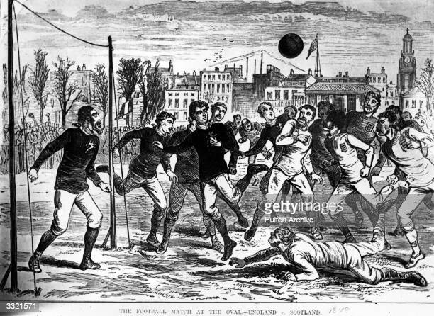 Players competing for the ball during an England versus Scotland football match at the Oval, England. The first recorded international football...