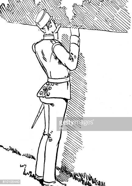 警察官はフェンスの上に立って、手の上の部分にそれの後ろに隠れて