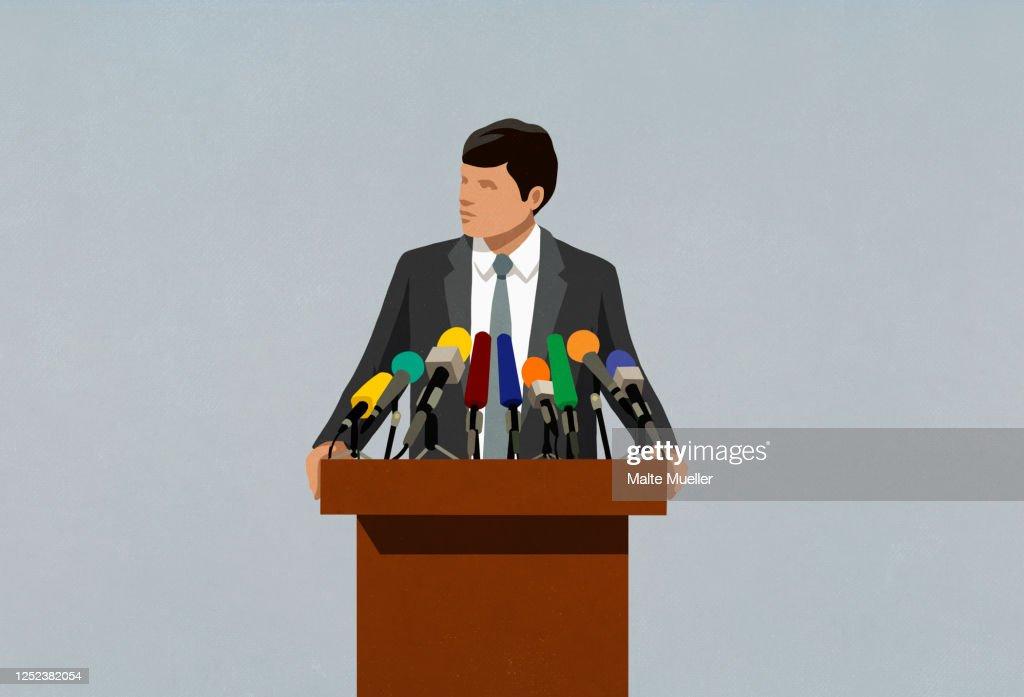 Politician speaking at microphones on podium : Stock Illustration