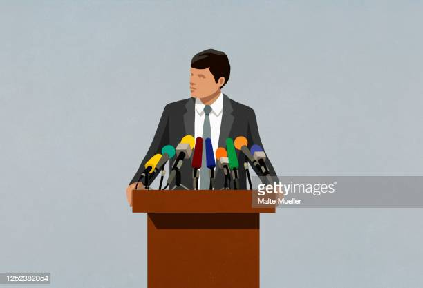 ilustraciones, imágenes clip art, dibujos animados e iconos de stock de politician speaking at microphones on podium - política y gobierno
