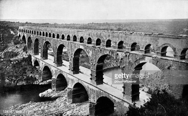 pont du gard roman aqueduct in nimes, france - 19th century - pont du gard stock illustrations