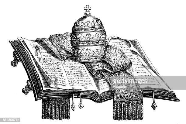 Pope hat and scarf on holy book