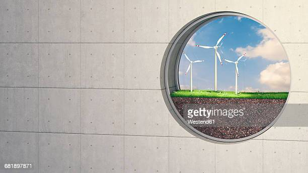 Porthole in concrete wall with wind turbines in nature