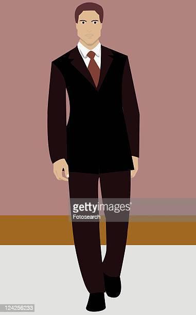 Portrait of a businessman walking