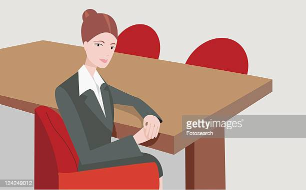 Portrait of a businesswoman sitting on an office chair