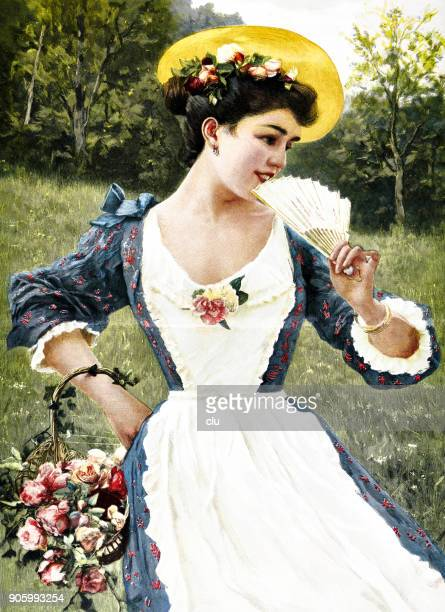 portrait of a happy young woman with rose basket on the meadow - young women stock illustrations