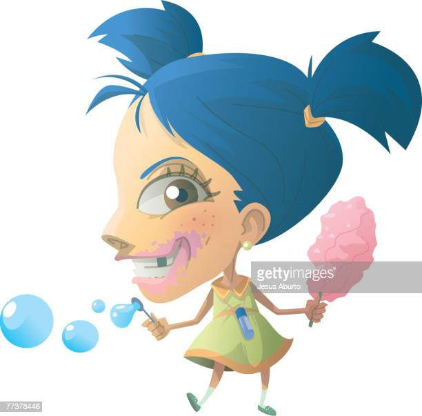 Portrait of a little girl eating candy and blowing bubbles