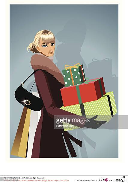 Portrait of a woman carrying Christmas presents