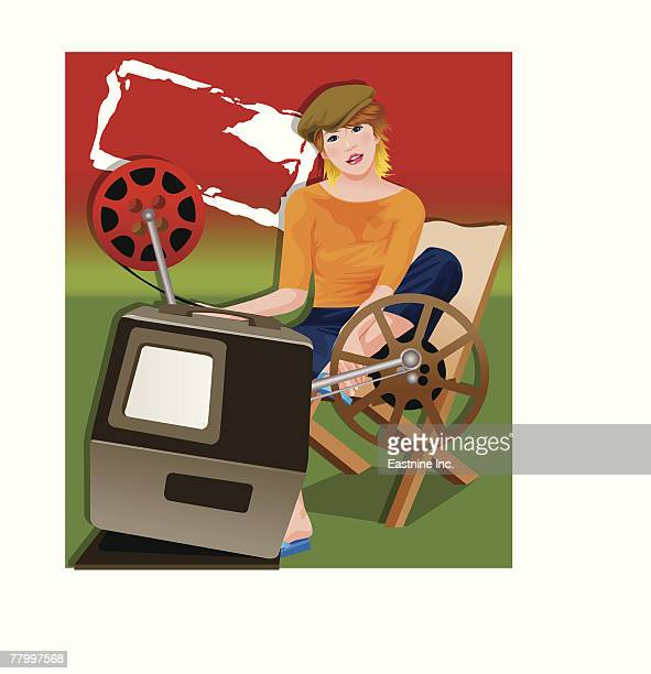 Portrait of a woman sitting in front of a film projector