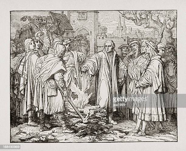 portrait of martin luther burning popes bull - protestantism stock illustrations