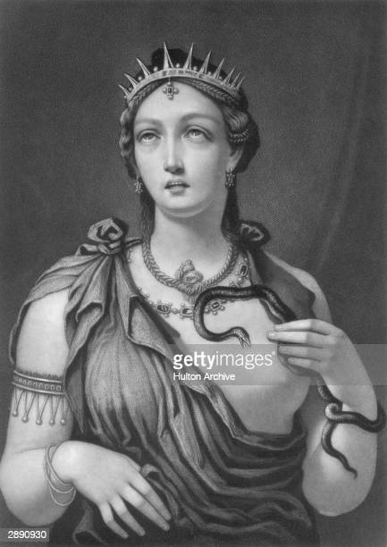 Portrait of Queen Cleopatra VII of Egypt who reigned from 5130 BC receiving the fatal bite on her breast from an asp 30 BC The engraving is by John...