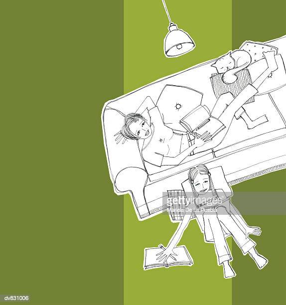 Portrait of Two Women Relaxing on Sofa at Home