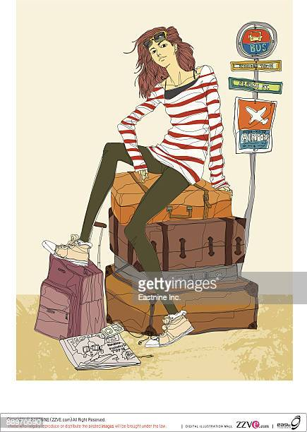 Portrait of young woman sitting on suitcase