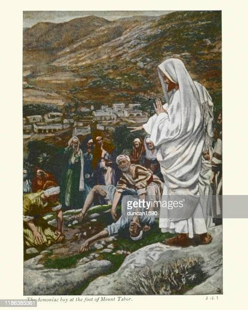 possessed boy at the foot of mount tabor. jesus - new testament stock illustrations