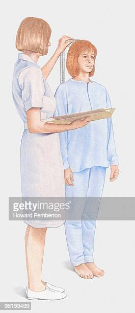 Pregnant woman's height being measured by a nurse