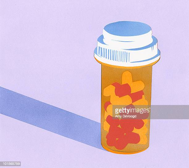 Prescription bottle filled with capsules