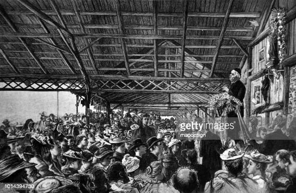priest preaches mass from the pulpit. crowds of people listen to his message - 1895 - preacher stock illustrations