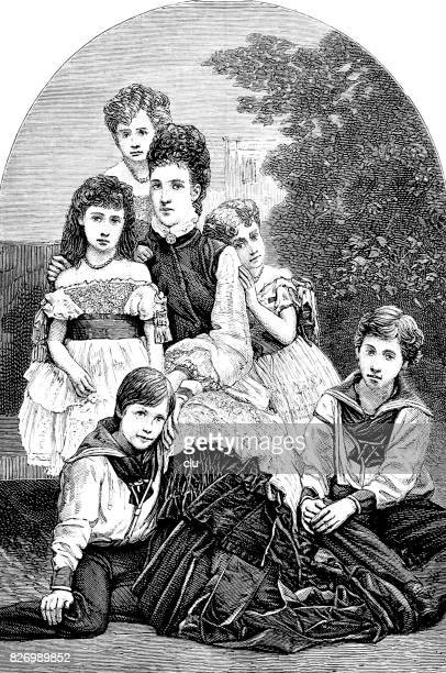 Princess of wales and her children, sitting outdoor in nature