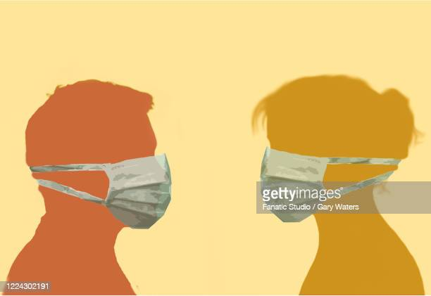 ilustrações, clipart, desenhos animados e ícones de profile image of a man and woman facing each other wearing surgical face masks depicting protection - female surgeon mask