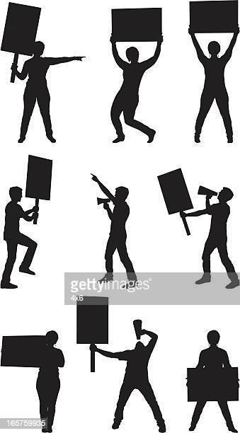 protesters with picket signs - protestor stock illustrations, clip art, cartoons, & icons