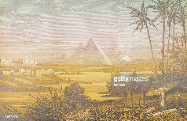 pyramids at sunset - egypt stock illustrations
