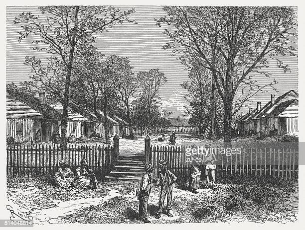 quarters of an american cotton plantation, wood engraving, published 1880 - black history in the us stock illustrations