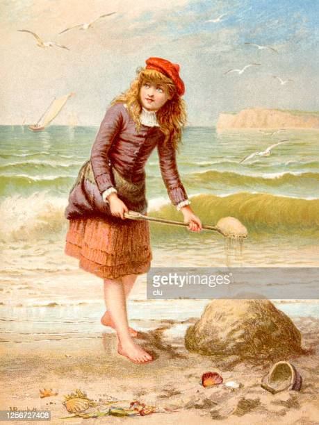 a queen of the beach, girl with long blond hair playing with sand and shovel - one teenage girl only stock illustrations