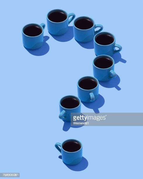 Question mark built of coffee mugs on light blue ground, 3D Rendering
