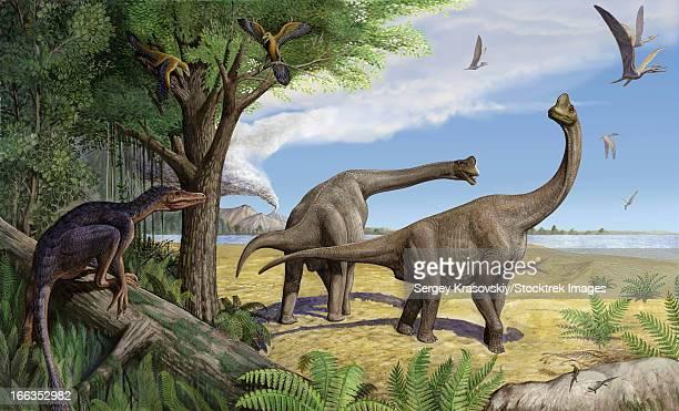 A raptor stalks a pair of grazing Europasaurus holgeri dinosaurs.