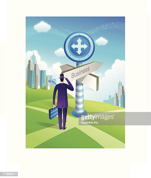 rear view of a businessman standing in front of a directional sign - full suit stock-grafiken, -clipart, -cartoons und -symbole