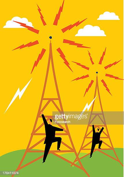 Rear view of maintenance engineers climbing on electricity pylon