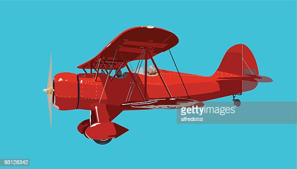 red biplane - biplane stock illustrations, clip art, cartoons, & icons