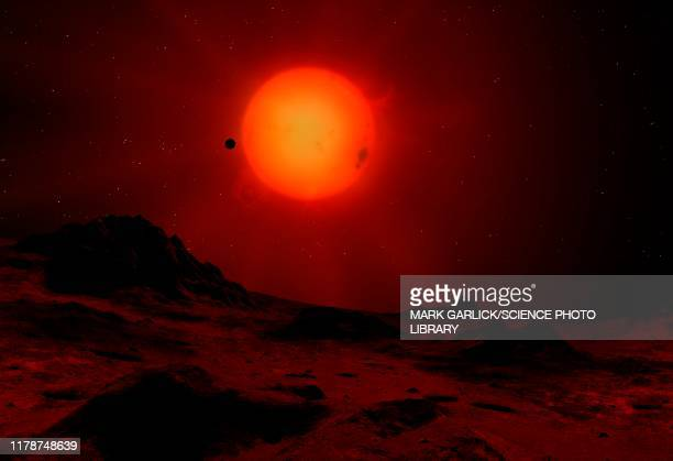 red dwarf seen from a planet, illustration - aurora borealis stock illustrations