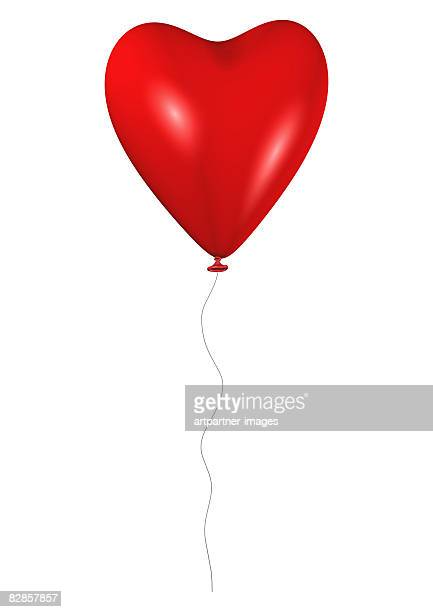 red heart balloon with cord flies on white