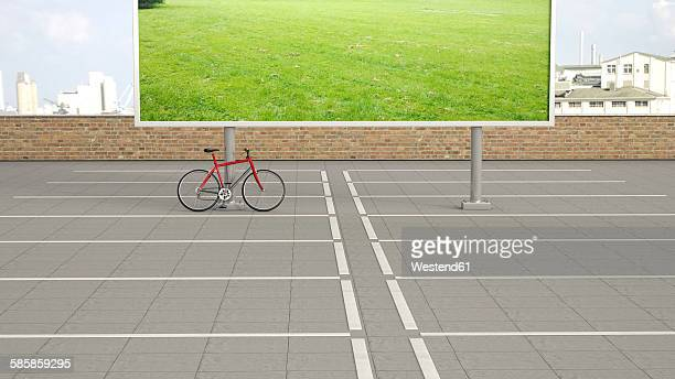 Red racing cycle standing on carpark in front of billboard showing a meadow, 3D Rendering