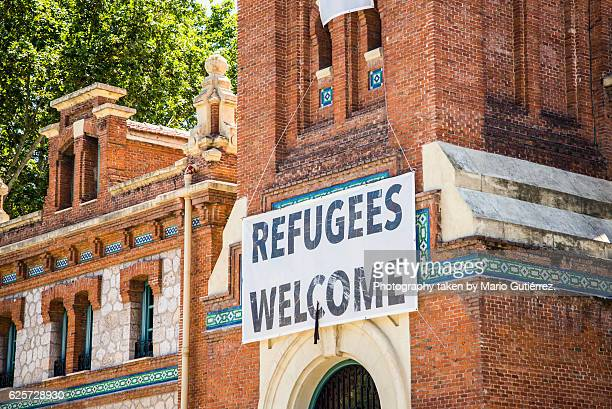 refugees welcome - giving stock illustrations