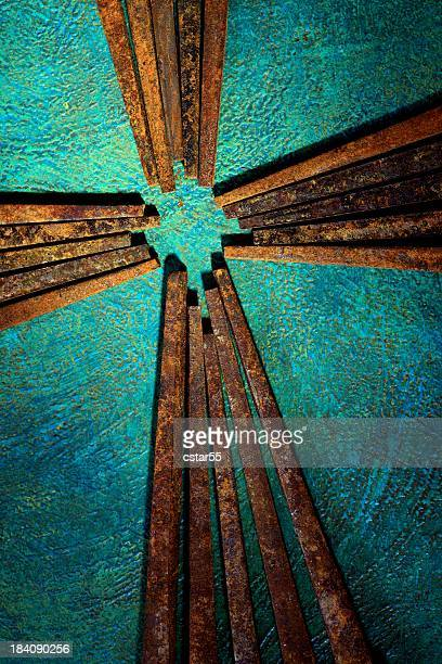 Religious: Cross of Old Square Rusty Nails with turquoise background