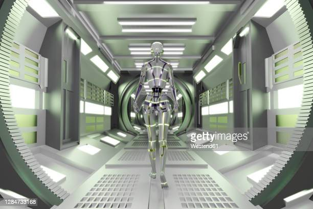 3d rendered illustration of gynoid in illuminated spaceship tunnel - automated stock illustrations