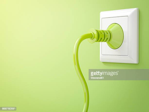 3d rendering, green plug in socket, clean energy, copy space - electric plug stock illustrations