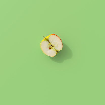 3D rendering, Halved apple on green background - gettyimageskorea