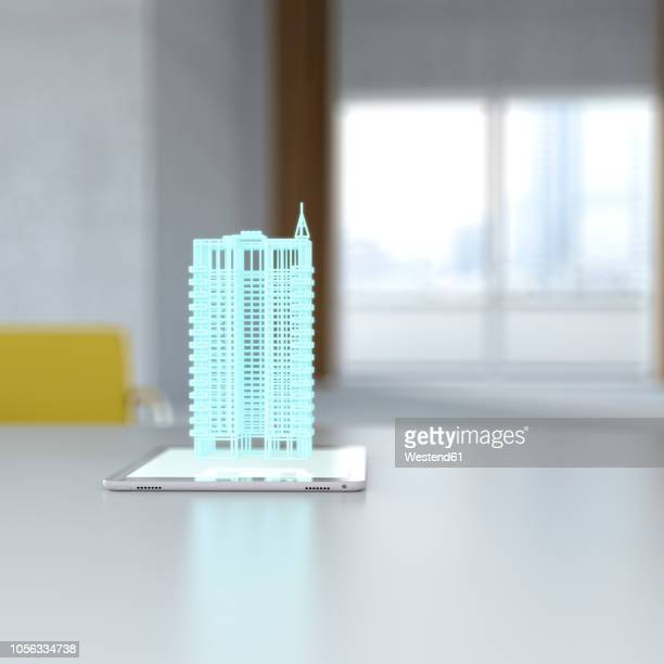 3D rendering, Hologram of building on digital tablet on desk
