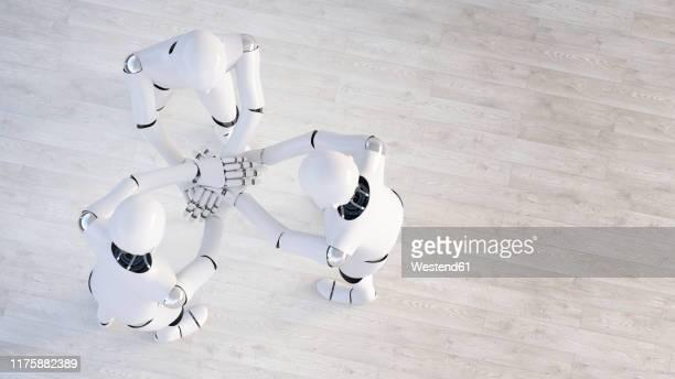 rendering of three robots stacking hands - 工業用ロボット点のイラスト素材/クリップアート素材/マンガ素材/アイコン素材
