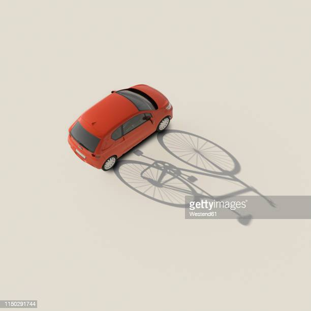 3d rendering, red car casting shadow of a bicycle - land vehicle stock illustrations