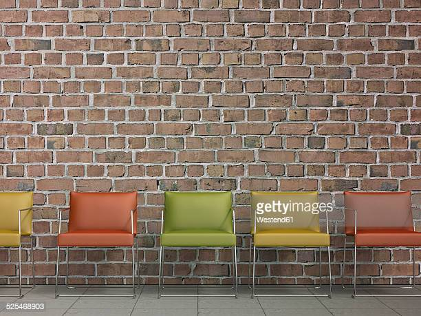 3D Rendering, row of chairs at brick wall