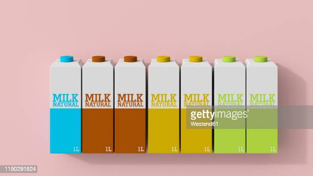 3d rendering, row of milk cartons in different colors - food and drink stock illustrations