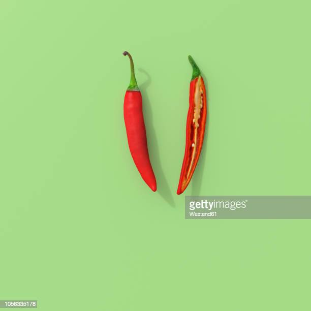 3d rendering, sliced red chili on green background - pepper vegetable stock illustrations