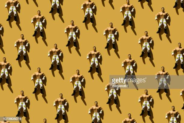 3d rendering, strong man with green heart wrestler trouser, repetition - human representation stock illustrations