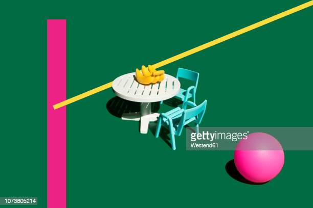 3d rendering, table, chairs, bananas, pink ball, miniature - small stock illustrations