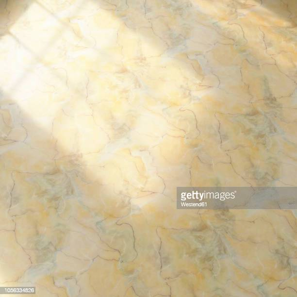 3D rendering, Yellow marble floor with light effects